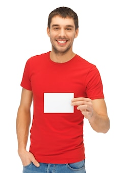 Image lumineuse de bel homme avec carte de note.