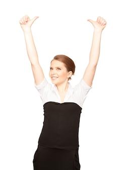 Image lumineuse de belle femme avec les pouces vers le haut