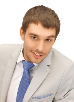 Image lumineuse du bel homme en costume.