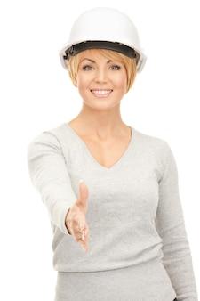 Image Lumineuse De L'entrepreneur Féminin En Casque Prêt Pour La Poignée De Main Photo Premium