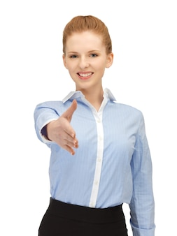 Image lumineuse de femme avec une main ouverte prête pour la poignée de main