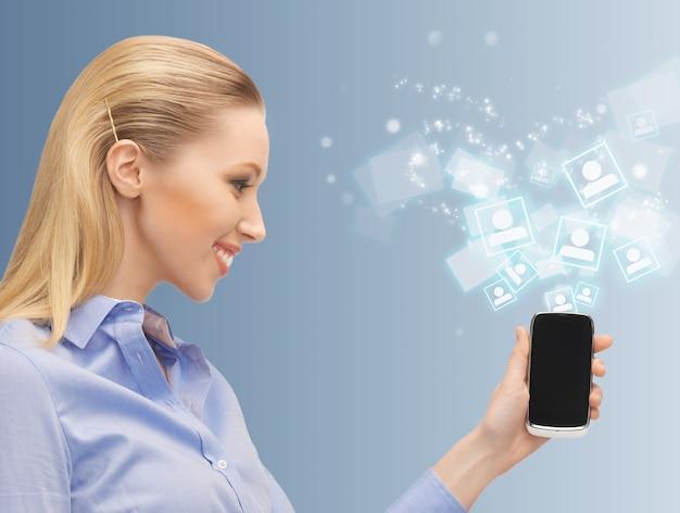 Image lumineuse d'une femme avec un téléphone portable