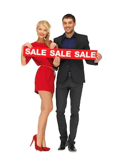 Image lumineuse de l'homme et de la femme avec signe de vente
