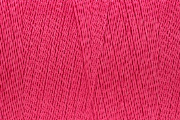 Image macro de fond de couleur rose texture fil