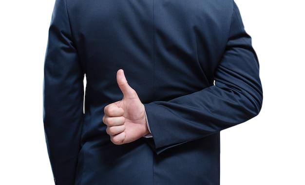 Image des mains d'un homme montrant un signe ok sur un fond blanc. vue arrière. concept d'entreprise. technique mixte