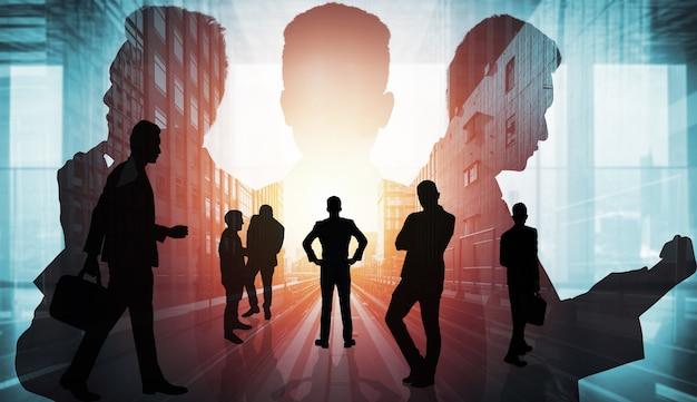 Image silhouette du groupe de gens d'affaires sur fond de ville