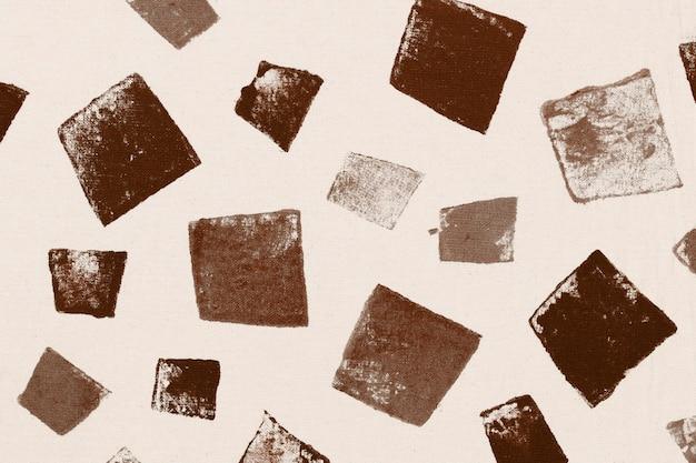 Impressions à la main de fond carré marron