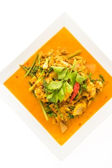 Incorporer le crabe frit au curry