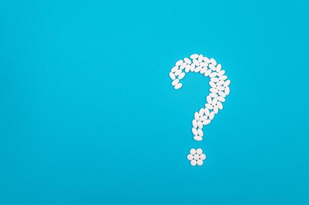 Industrie pharmaceutique et produits médicinaux de point d'interrogation blanc