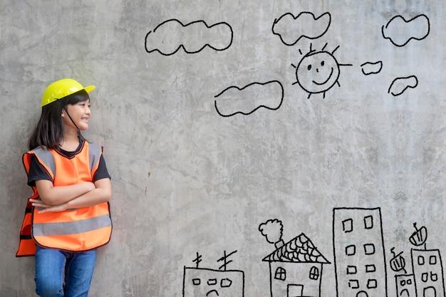 Ingénierie de petite fille asiatique avec un environnement de dessin créatif avec une famille heureuse,