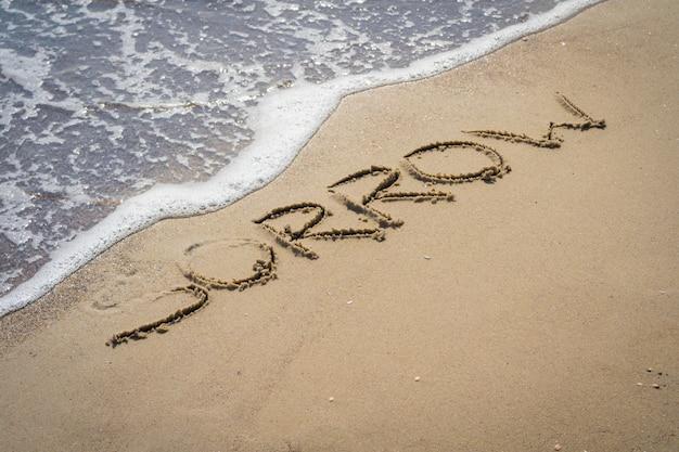Inscription de chagrin sur le sable
