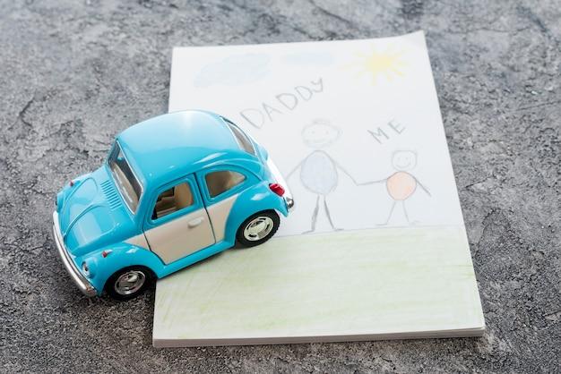 Inscription papa et moi avec une voiture miniature