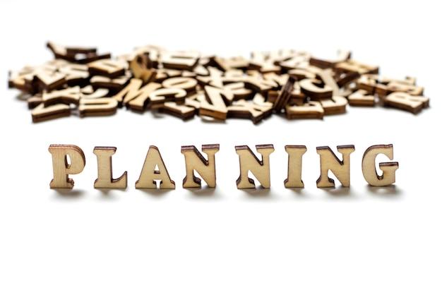 Inscription planning écrit lettres en bois close-up, le concept de planification