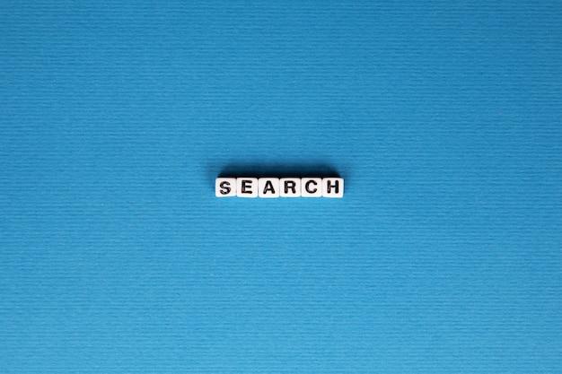 Inscription de recherche sur fond bleu