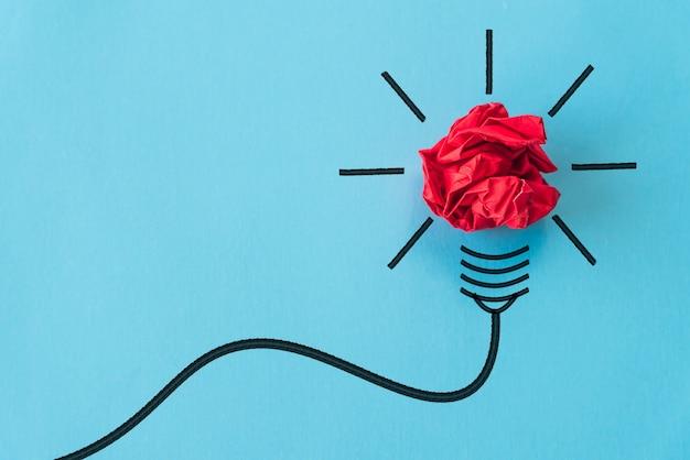 Inspiration et idée géniale sur fond bleu.