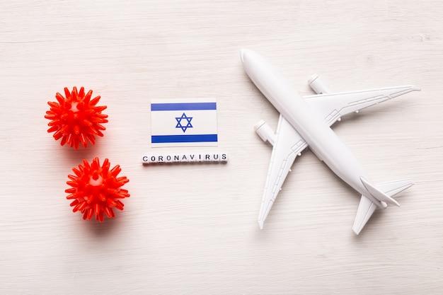 Interdiction de vol et fermeture des frontières pour les touristes et les voyageurs atteints de coronavirus covid-19. avion et drapeau d'israël sur fond blanc. pandémie de coronavirus.