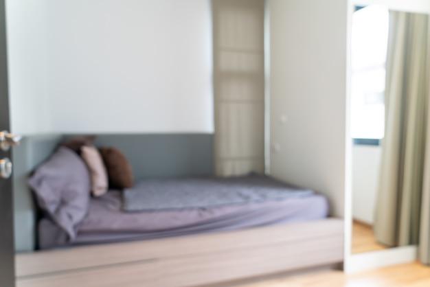 Intérieur de chambre à coucher flou abstrait pour le fond