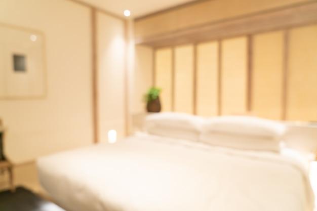 Intérieur de chambre à coucher de l'hôtel de luxe flou