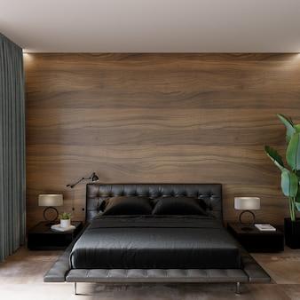 Intérieur de la chambre avec lit noir et décors devant le mur en bois