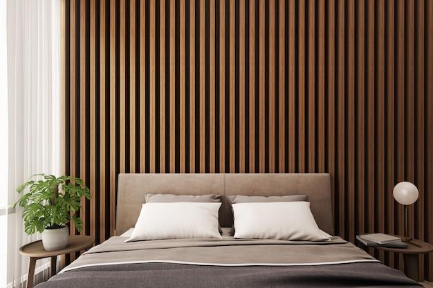 Intérieur de la chambre, lit et table d'appoint avec panneau mural en bois.