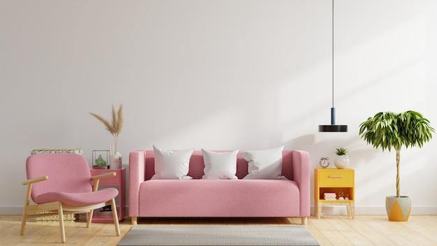 L'intérieur du salon moderne lumineux et confortable a un canapé rose, un fauteuil et une lampe avec un fond de mur blanc.