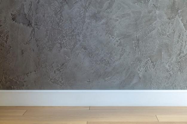 Intérieur de la pièce vide avec fond de mur gris foncé et mur texturé vide de plancher en bois