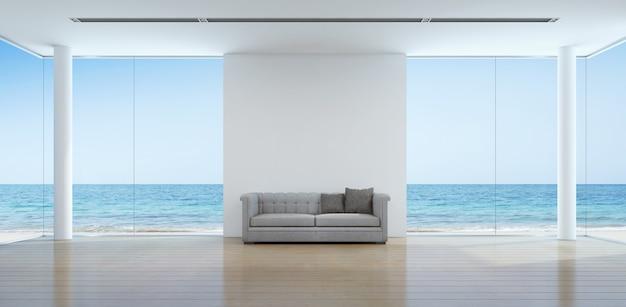 Intérieur de salon vue mer dans maison de plage moderne.