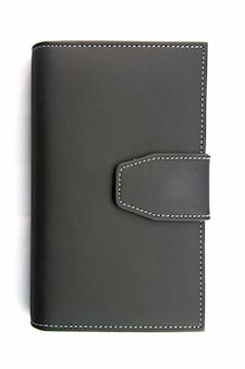 Isolé de cahier de support en faux cuir noir sur blanc