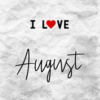 J'aime august lettrage dessiné à la main sur du papier froissé gris