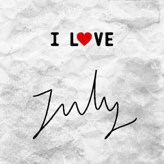 J'aime les lettres de juillet dessinées à la main sur du papier froissé gris