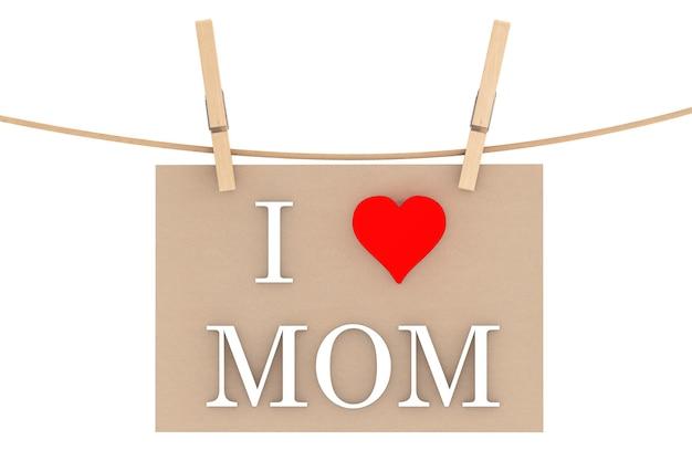 J'aime maman avec coeur suspendu avec des pinces à linge sur fond blanc