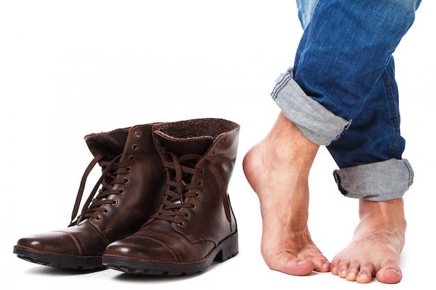 Jambes et bottes en cuir