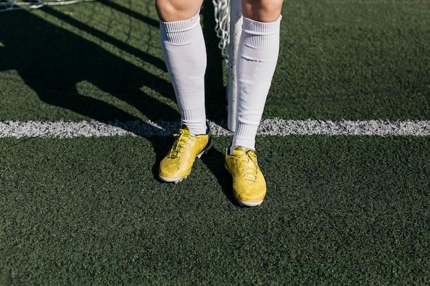 Jambes du joueur de football