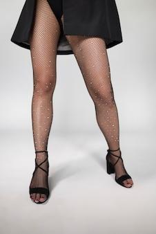 Jambes de modèle en bas collants