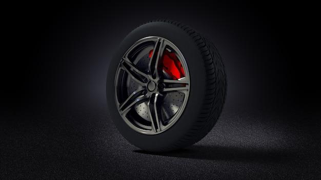 Jante de voiture et pneu debout sur route asphaltée