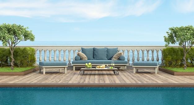 Jardin avec piscine et canapé rétro devant une balustrade classique