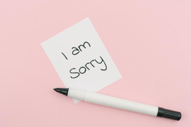 Je suis désolé texte concept écrire sur papier
