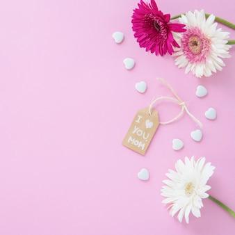 Je t'aime inscription maman avec des fleurs de gerbera