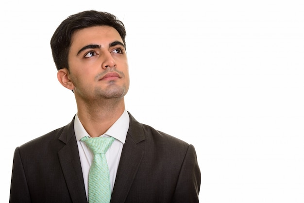 Jeune bel homme d'affaires pensant et levant