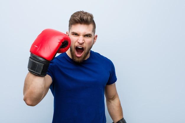 Jeune, caucasien, homme, porter, a, gants boxe
