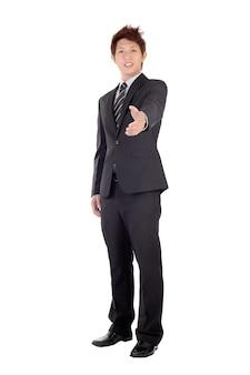Jeune entrepreneur, serrer la main avec vous, portrait en pied isolé sur blanc.