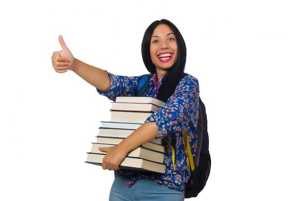 Jeune étudiante avec des livres sur blanc