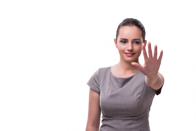 Jeune femme d'affaires en appuyant sur le bouton virtuel isolé sur blanc
