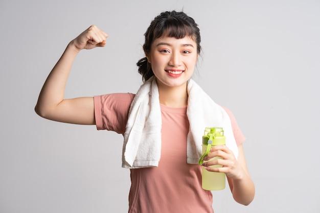 Jeune, femme asiatique, faire, exercice, blanc