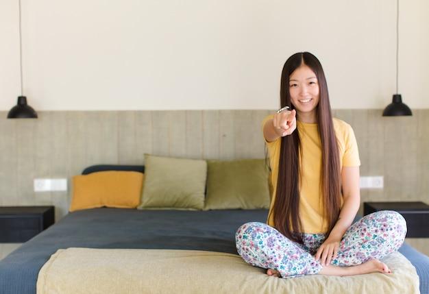 Jeune femme asiatique, pointage