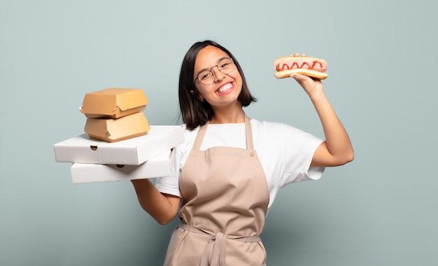 Jeune femme jolie chef. concept de restauration rapide