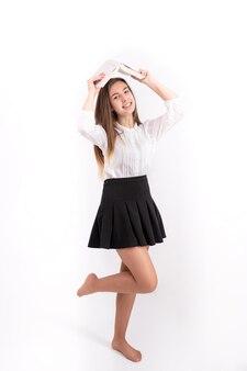 Jeune femme, à, livre, blanc, fond