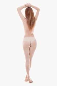 Jeune femme, poser, seins nus, peau parfaite, vue postérieure
