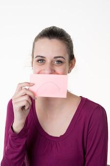 Jeune, femme, post-it, note, bouche, sourire
