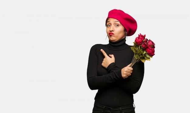Jeune femme à la saint-valentin décider entre deux options